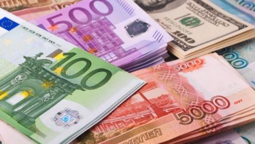 Доллар и рубль выросли на торгах