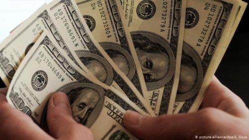 МВФ считает курс доллара США значительно завышенным