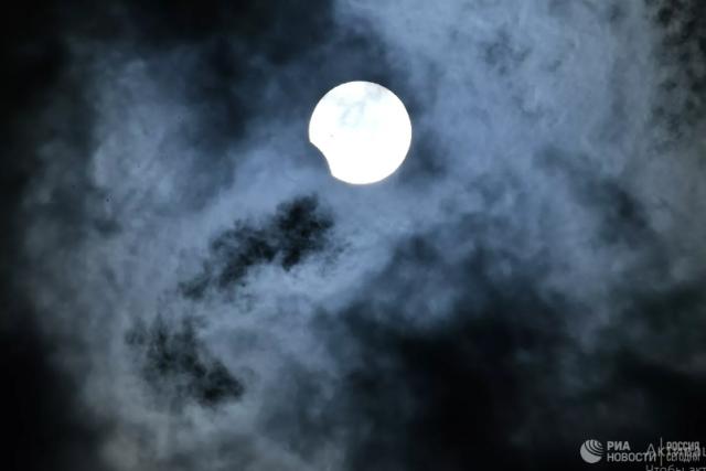 Астронавт сфотографировал с борта МКС тень от затмения на Земле